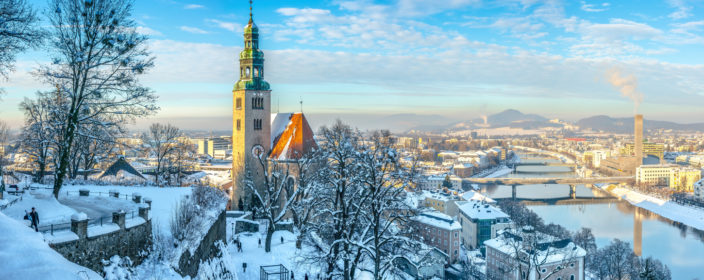 Beautiful panoramic view of Salzburg skyline with Muellner Church and river Salzach in winter, Salzburger Land, Austria