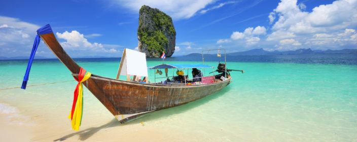 Docking Thai boat in island bay, south of Thailand
