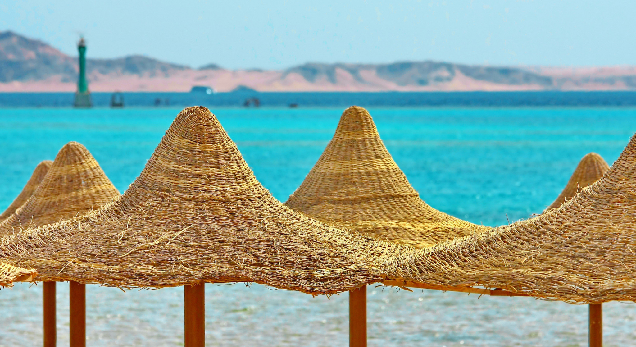 Umbrellas-and-Red-Sea-on-mount-background-177531415_2201x1200